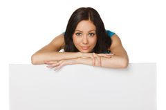 Woman leaning on whiteboard Royalty Free Stock Photography