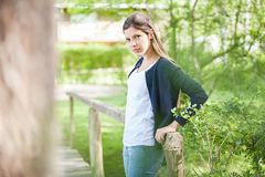 Woman Leaning On Wooden Bridge Stock Image