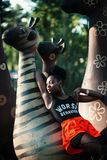 Woman Leaning on Zebra Statue Royalty Free Stock Image