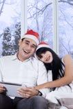 Woman leans on her boyfriend shoulder Stock Photo