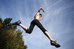 Woman leaping Stock Image