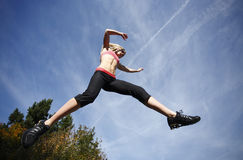 Woman leaping Stock Photos