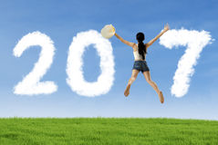 Woman leaping with number 2017 Stock Images
