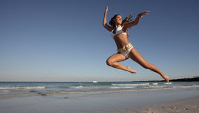 Woman Leaping On The Beach Royalty Free Stock Photo