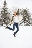 Woman leaping in snow. Royalty Free Stock Photos