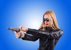 Woman in lear suit with handgun Royalty Free Stock Photo