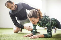 Woman learn exercises with personal trainer royalty free stock images