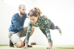 Woman learn with personal trainer stock photos