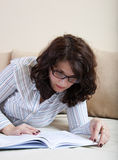 Woman learning in bed Stock Images