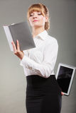 Woman learning with ebook and book. Education. Royalty Free Stock Image