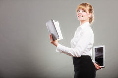 Woman learning with ebook and book. Education. Stock Photography