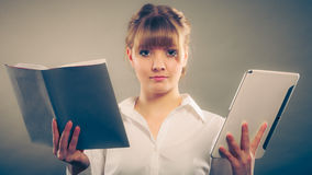 Woman learning with ebook and book. Education. Stock Image