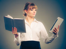 Woman learning with ebook and book. Education. Royalty Free Stock Photos