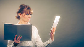 Woman learning with ebook and book. Education. Stock Images