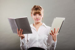 Woman learning with ebook and book. Education. Stock Photos