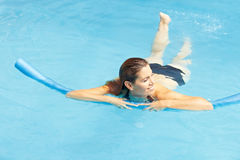 Woman learning swimming with swim Royalty Free Stock Image