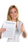 Woman with a lease in English. A young woman has successfully completed a lease. In English Royalty Free Stock Images