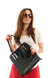 Woman with leather bag Stock Images