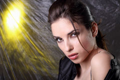Woman in  leather black  costume Stock Photos