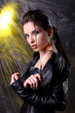 Woman in  leather black  costume Royalty Free Stock Photos