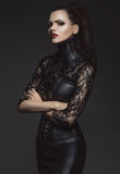 Woman in leather clothes Stock Photo