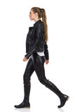 Woman In Leather Clothes Walking Royalty Free Stock Photo