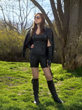 Woman in leather clothes with whip Royalty Free Stock Images