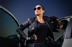 Woman in leather clothes Stock Photography