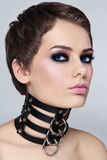 Woman in leather collar. Portrait of young beautiful sexy woman in black leather collar Stock Photo