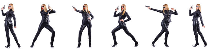 The woman in leather costume with gun isolated on white Stock Photography