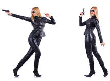 The woman in leather costume with gun isolated on white Royalty Free Stock Image