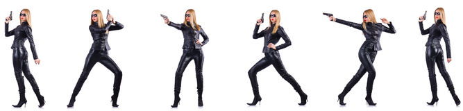 The woman in leather costume with gun isolated on white. Woman in leather costume with gun isolated on white royalty free stock photo