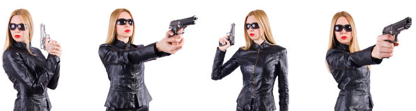 The woman in leather costume with gun isolated on white Stock Photos