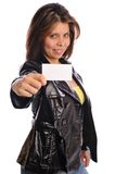 Woman in leather hold a business card Royalty Free Stock Photo