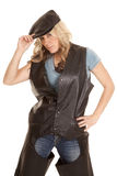 Woman in leather hold hat looking Royalty Free Stock Photography