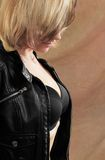 Woman and leather jacket Stock Photos