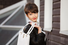 Fashion woman in leather jacket with handbag Royalty Free Stock Image