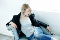Woman in a leather jacket Stock Images