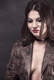 Woman in leather jacket Stock Images