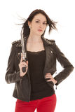 Woman leather jacket gun hair blown Royalty Free Stock Photography