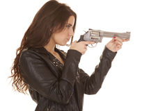 Woman leather jacket gun point Royalty Free Stock Photography