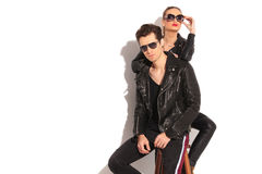 Woman in leather jacket leaning her elbow on her man Royalty Free Stock Photo