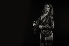 Woman in leather jacket and lingerie on black bakcground Stock Photo