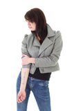 Woman in leather jacket showing her tattoo Stock Images