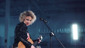 Woman in leather jacket singing stock video footage