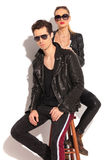 Woman in leather jacket standing behind her man Stock Photo