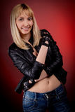 Woman in leather jacket studio Royalty Free Stock Images
