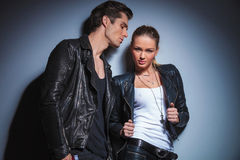 Woman in leather jacket takes it off while posing Stock Photo