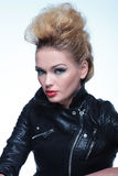 Woman in leather jacket wearing beautiful make up Stock Images