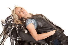 Woman leather lay back on motorcycle smile royalty free stock images